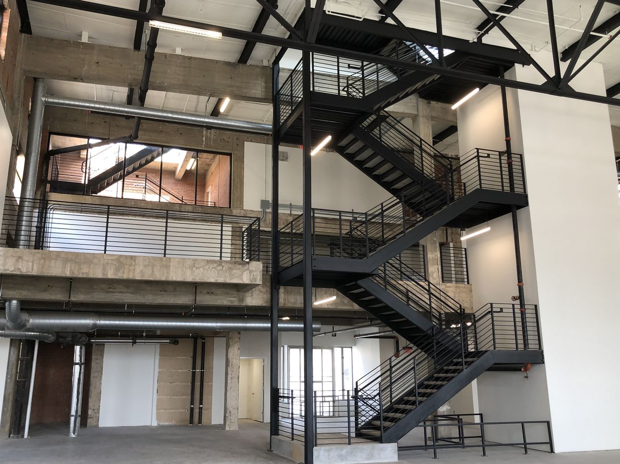A stairway leads to the mezzanine and roof deck.