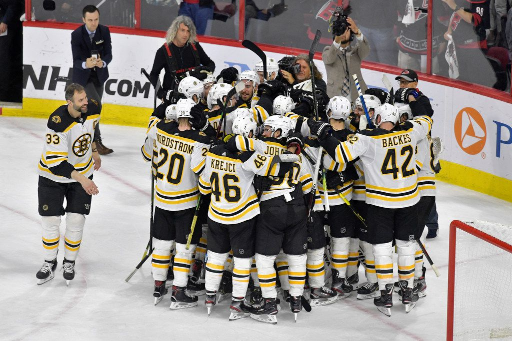 RALEIGH, NORTH CAROLINA - MAY 16: The Boston Bruins celebrate after defeating the Carolina Hurricanes in Game Four to win the Eastern Conference Finals during the 2019 NHL Stanley Cup Playoffs at PNC Arena on May 16, 2019 in Raleigh, North Carolina. (Photo by Grant Halverson/Getty Images)