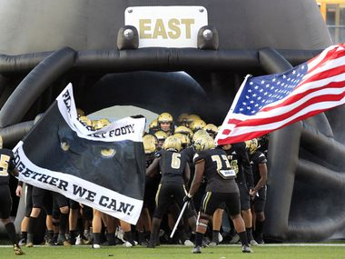 The Plano East team prepares to enter the field before the first half of a high school football game against the Lewisville and Plano East High at Kimbrough Stadium in Murphy on Friday, October 1, 2021. (John F. Rhodes / Special Contributor)
