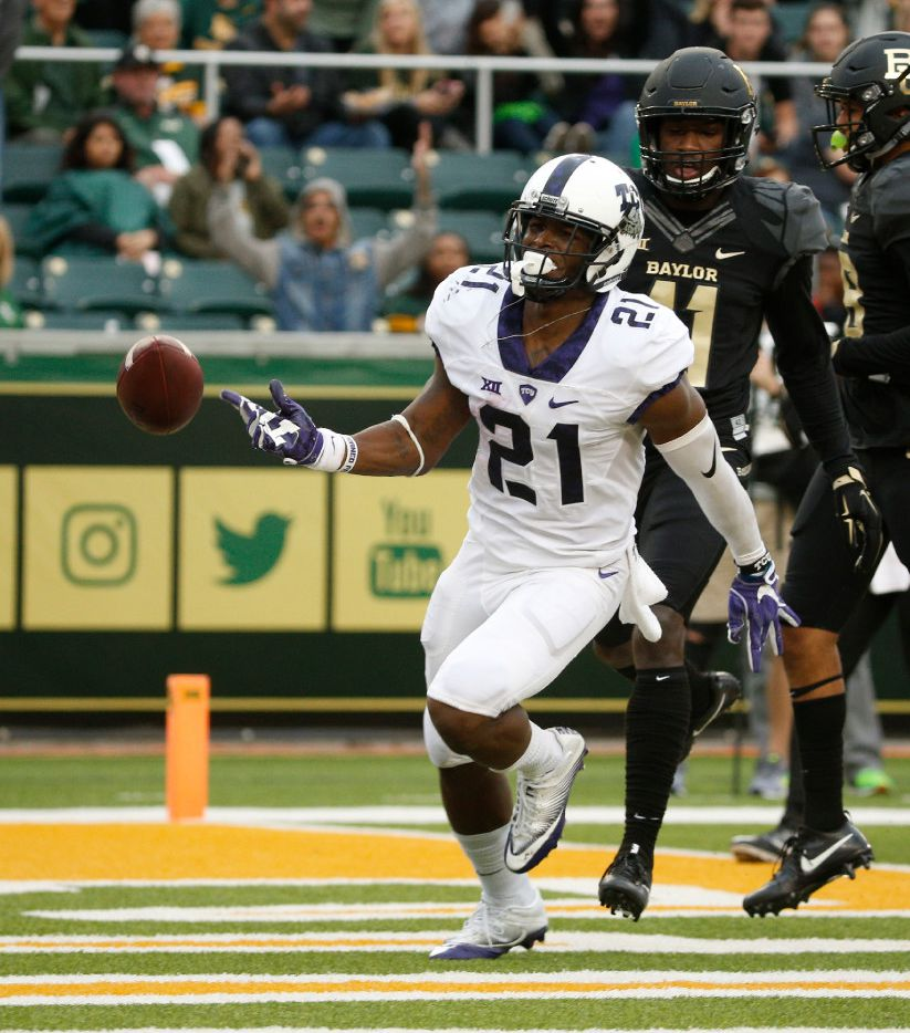 TCU Horned Frogs running back Kyle Hicks (21) runs in a touchdown against the Baylor Bears in the first half at McLane Stadium in Waco, Texas on Nov. 5, 2016.  TCU was leading 38-14 at the half. (Nathan Hunsinger/The Dallas Morning News)