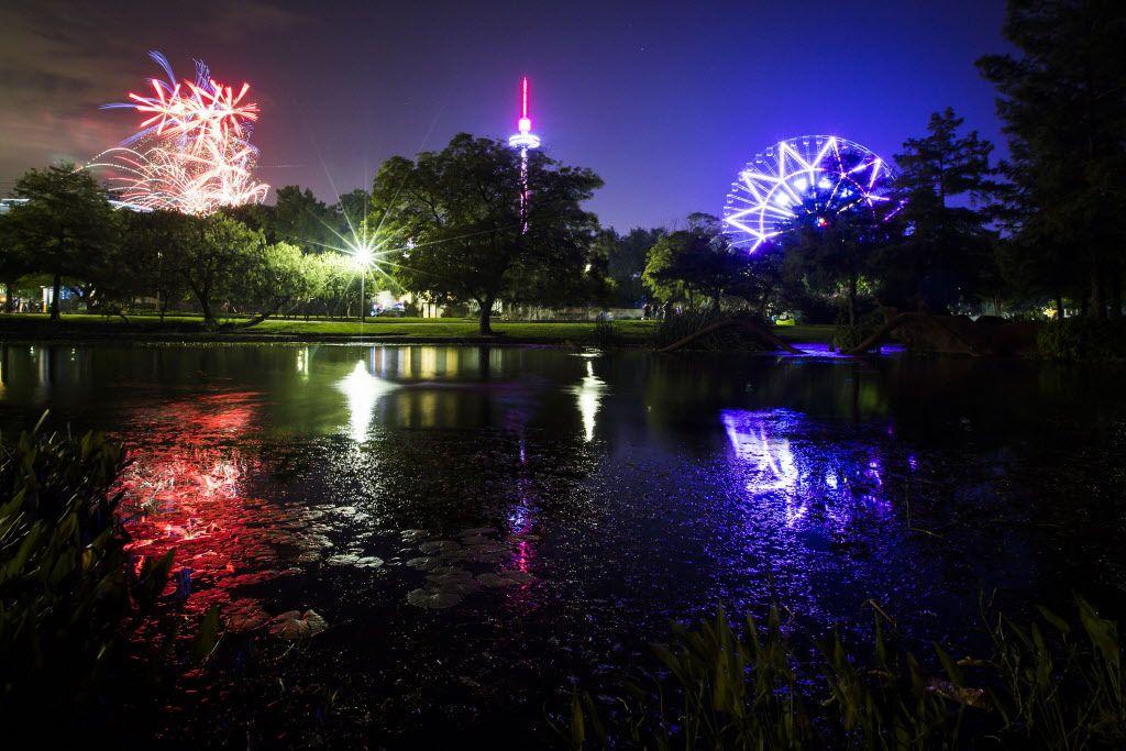 Fireworks light up over the Leonhardt Lagoon during an earlier Fair Park Fourth celebration in Fair Park.