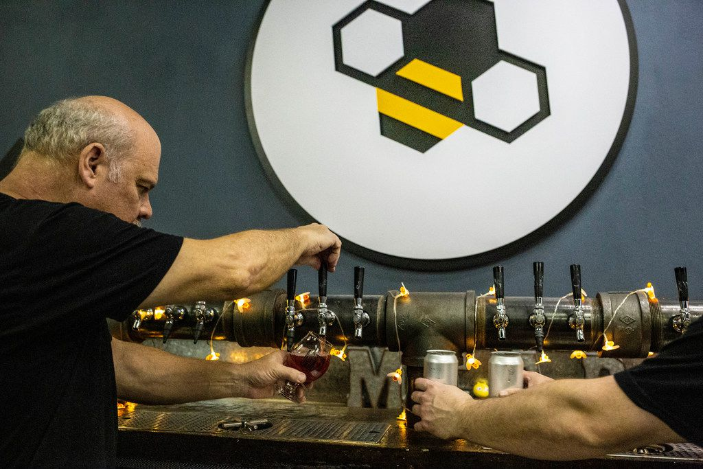 Owner Gary Gordon, left, and Blake Gordon pour mead at Breaking Brew Meadery.
