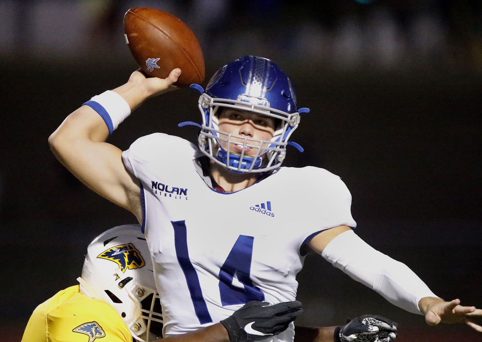 Nolan Catholic High School quarterback Jimmy Taylor (14) is hurried to get off a pass during the first half as Prestonwood Christian Academy hosted Nolan Catholic High School at Lions Stadium in Plano on Friday night, October 9, 2020. (Stewart F. House/Special Contributor)