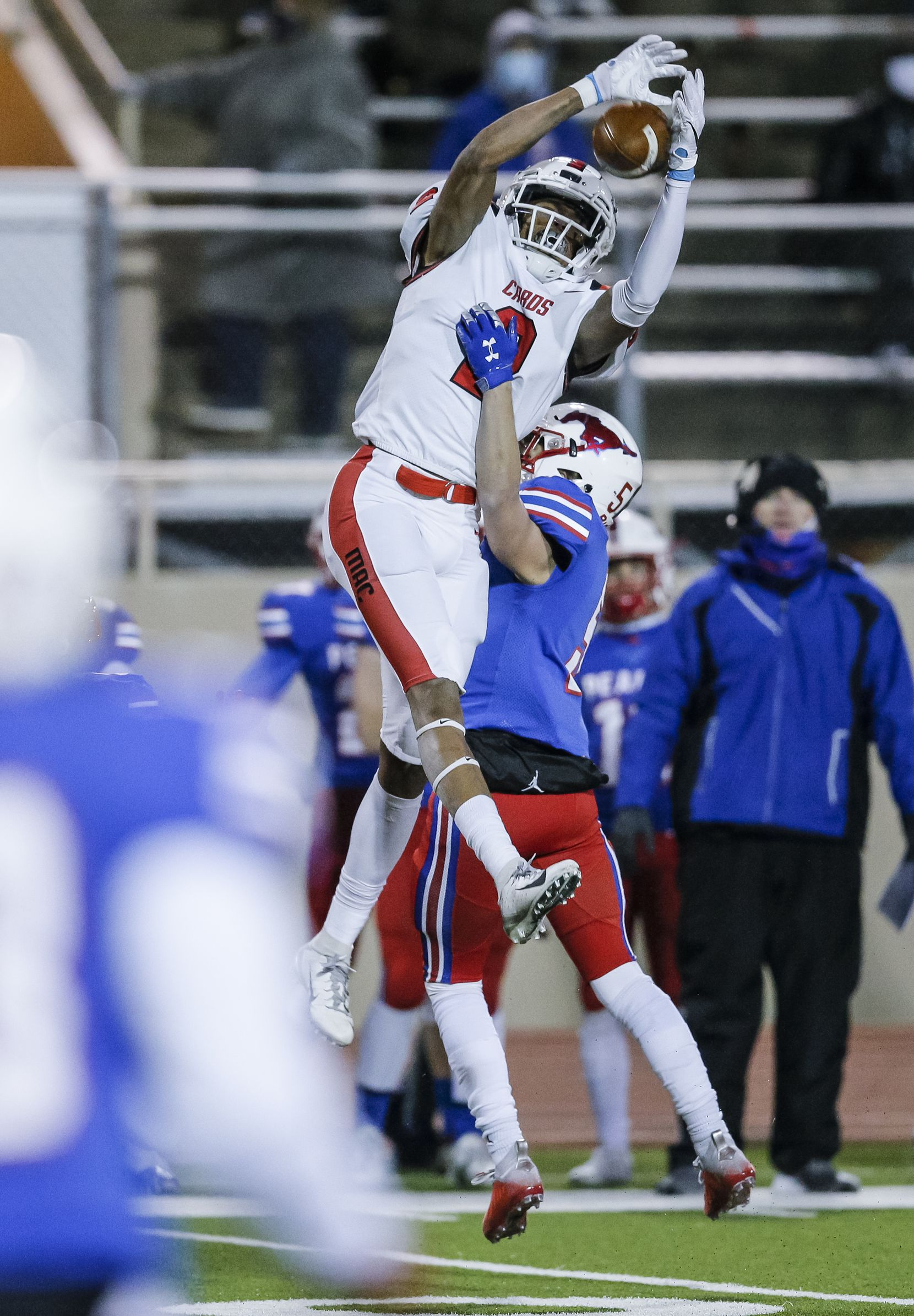 Irving MacArthur senior Lee Hamilton (2) is unable to catch a pass as JJ Pearce Demond White (5) defends during the first half of a high school playoff football game at Eagle-Mustang Stadium in Richardson, Thursday, December 3, 2020. (Brandon Wade/Special Contributor)