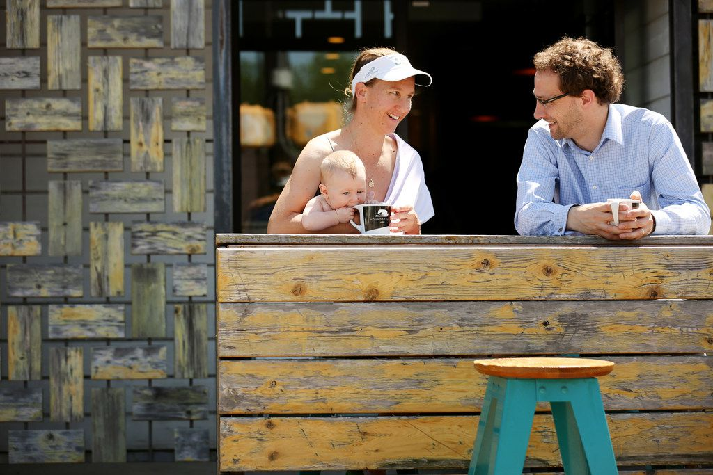 Dominique Fisher (left) and her husband Jon Fisher sit with their 4-month-old son Francis Fisher outside Houndstooth Coffee along Henderson Avenue between Central Expressway and Ross Avenue in Dallas Tuesday April 24, 2018. (Andy Jacobsohn/The Dallas Morning News)
