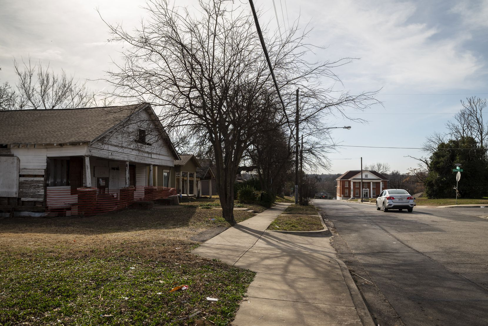 An abandoned home and the Greater El Bethel Missionary Baptist Church in the Tenth Street Historic District of Dallas.