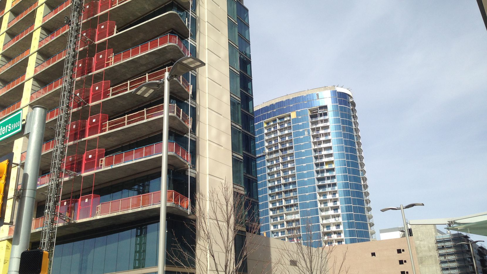 Construction on Legacy West's Windrose Tower condos, on the left, and the LVL 29 apartment high-rise is finishing up.