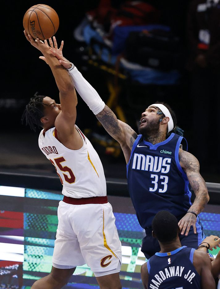 Dallas Mavericks center Willie Cauley-Stein (33) attempts to block a shot by Cleveland Cavaliers forward Isaac Okoro (35) during the first quarter at the American Airlines Center in Dallas, Friday, May 7, 2021. (Tom Fox/The Dallas Morning News)
