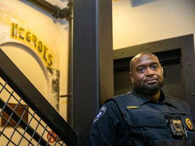 "Ellis County Constable Precinct 3 Curtis Polk Jr. poses for a photo at the Ellis County Courthouse in Waxahachie, Texas. His office was recently moved to a basement, where a segregation-era sign with the word ""negroes"" is painted nearby."