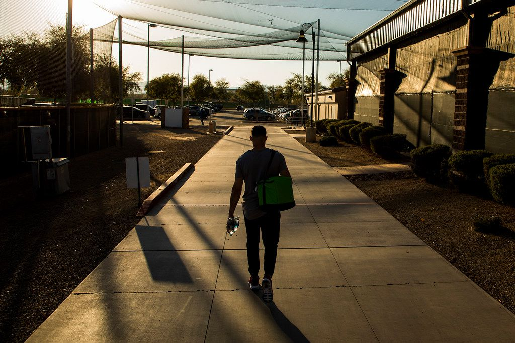05:22 PM -- Nearly 12 hours after he arrived at the complex, Texas Rangers infielder/outfielder Drew Robinson ends his workday after a spring training baseball game on Monday, Feb. 26, 2018, in Surprise, Ariz.