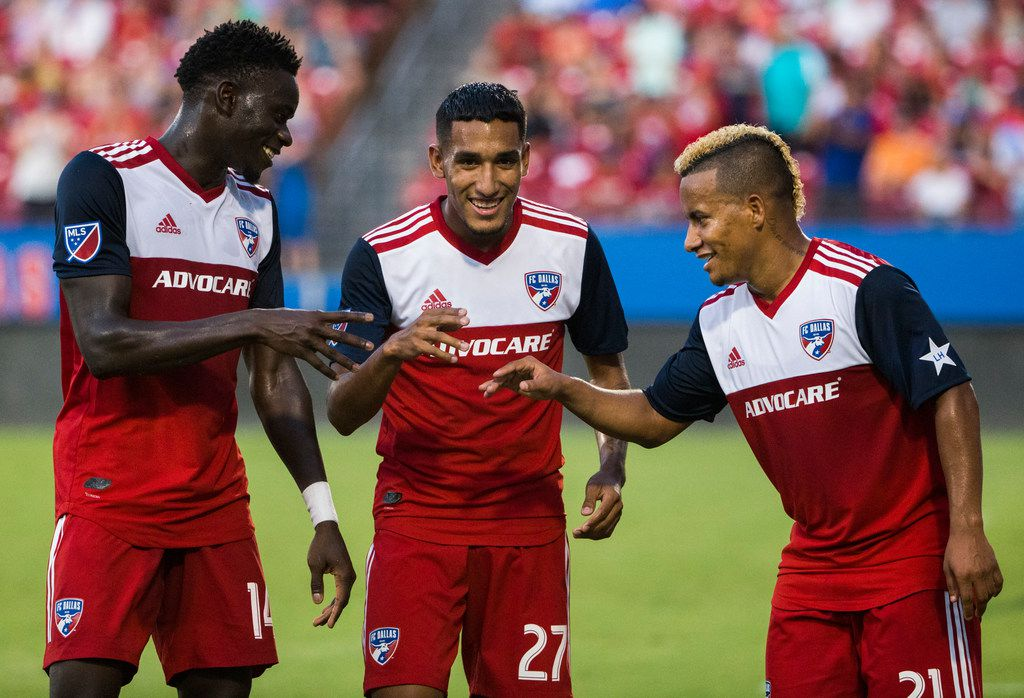 FC Dallas forward Jesus Ferreira (27, middle) celebrates with forward Dominique Badji (14) and midfielder Michael Barrios (21) after kicking a goal during the first half of an MLS game between FC Dallas and Houston Dynamo on Sunday, August 25, 2019 at Toyota Stadium in Frisco, Texas. (Ashley Landis/The Dallas Morning News)