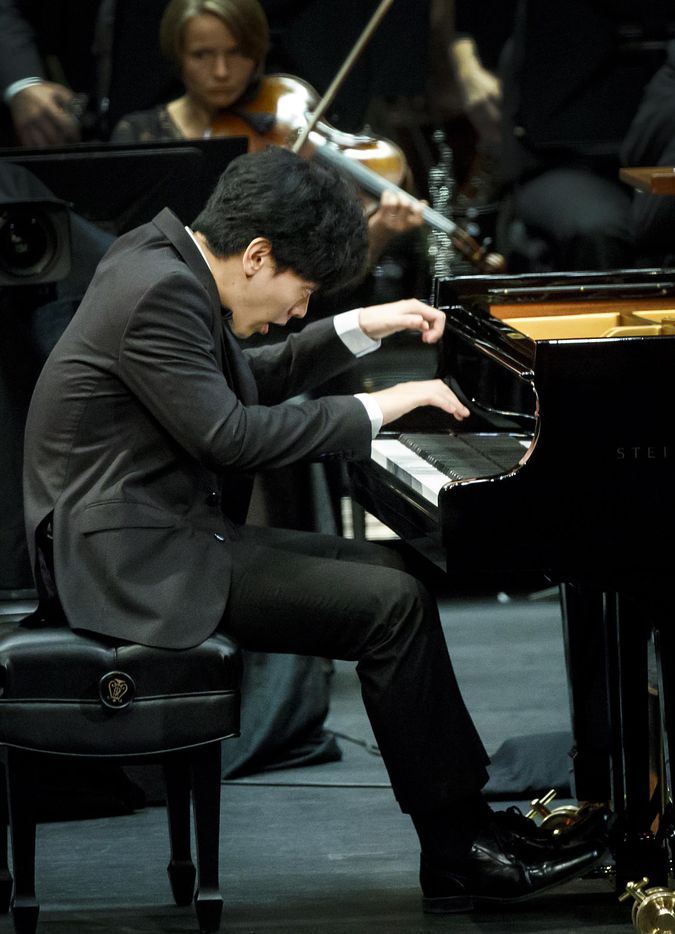 Daniel Hsu of the USA performs a piano concerto with the Fort Worth Symphony Orchestra, led by Leonard Slatkin, in the final round of the Van Cliburn International Piano Competition at Bass Performance Hall on Saturday, June 10, 2017, in Fort Worth. (Smiley N. Pool/The Dallas Morning News)