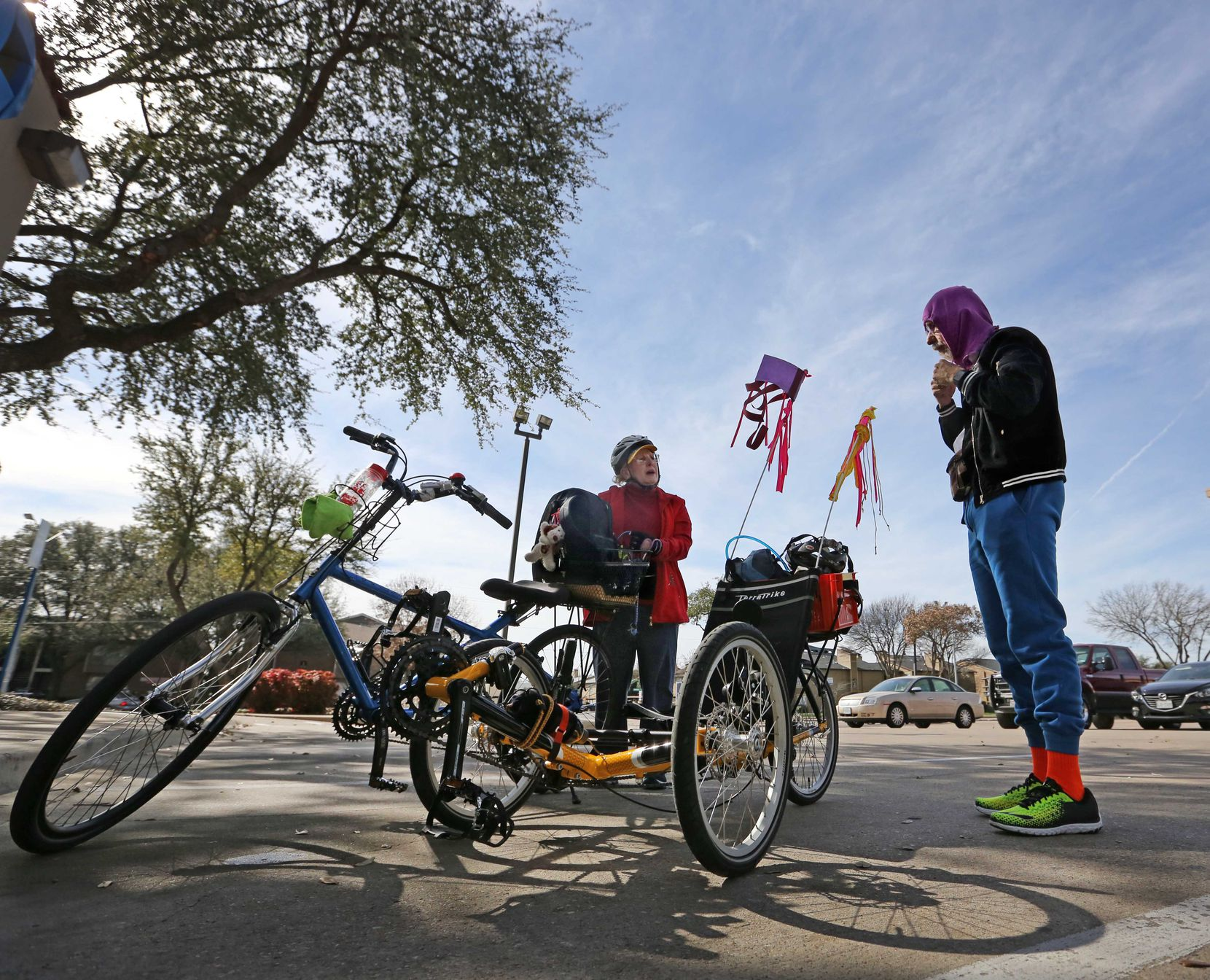 The Weisses make a stop at the bank as they run errands by bicycle near their home. (Louis DeLuca/Staff Photographer)
