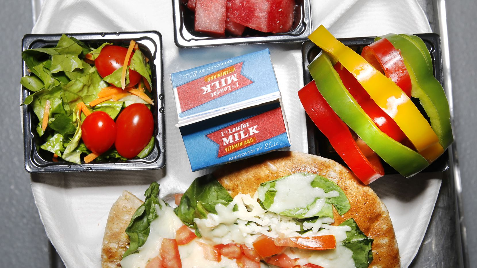 Restaurant critic Leslie Brenner went to Dallas Independent School District's production facility last year to taste test healthy 'Smart Box' lunches.  One was this Mediterranean Combo Meal with spinach-cheese flatbread and Texas watermelon.