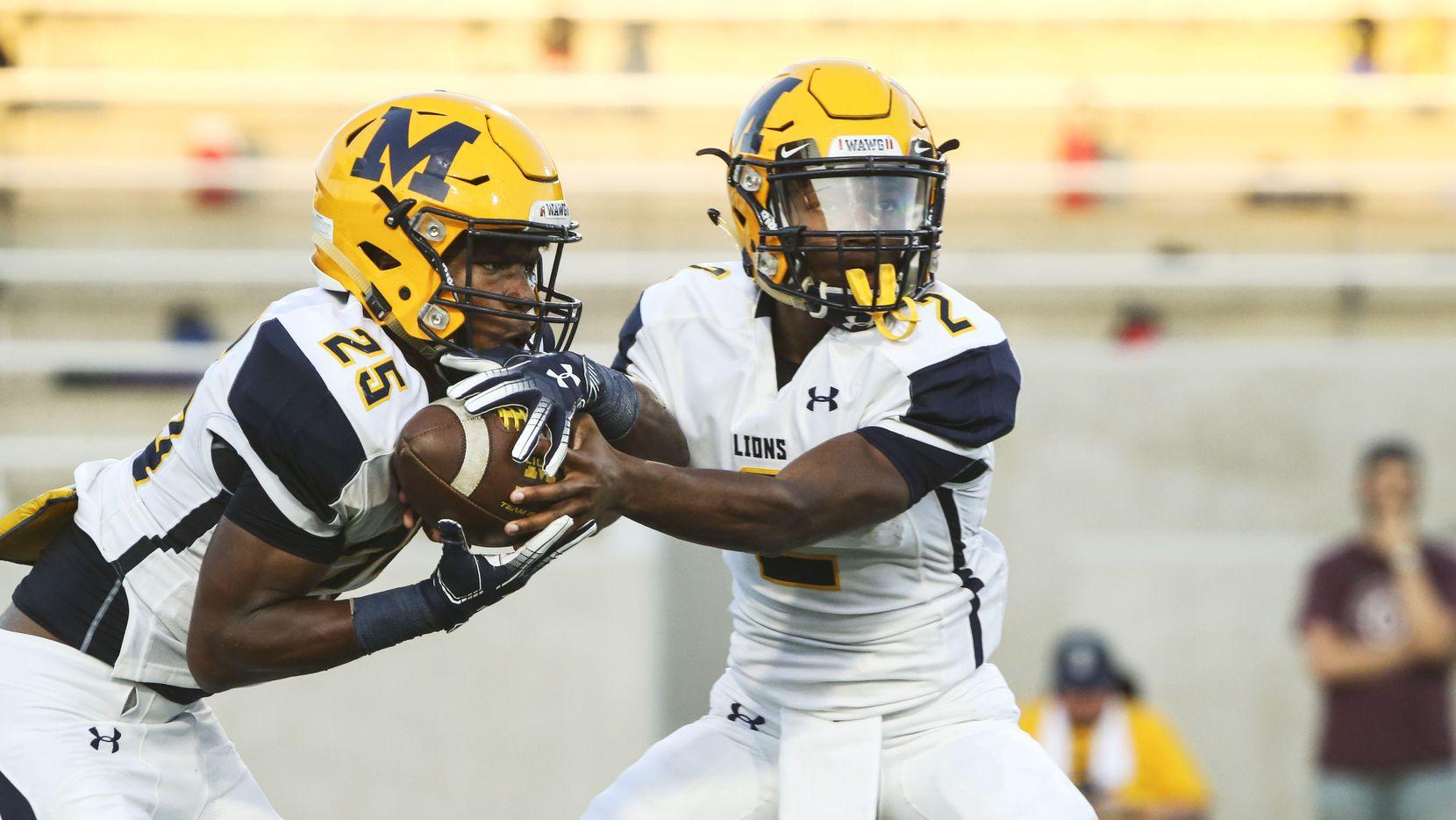 McKinney's Adrian Shepherd (25), left, grabs the ball as Kelvin Thomas (2) passes during a high school football game between McKinney and McKinney North on Thursday, on Aug. 30, 2018 at McKinney ISD stadium in McKinney, Texas.