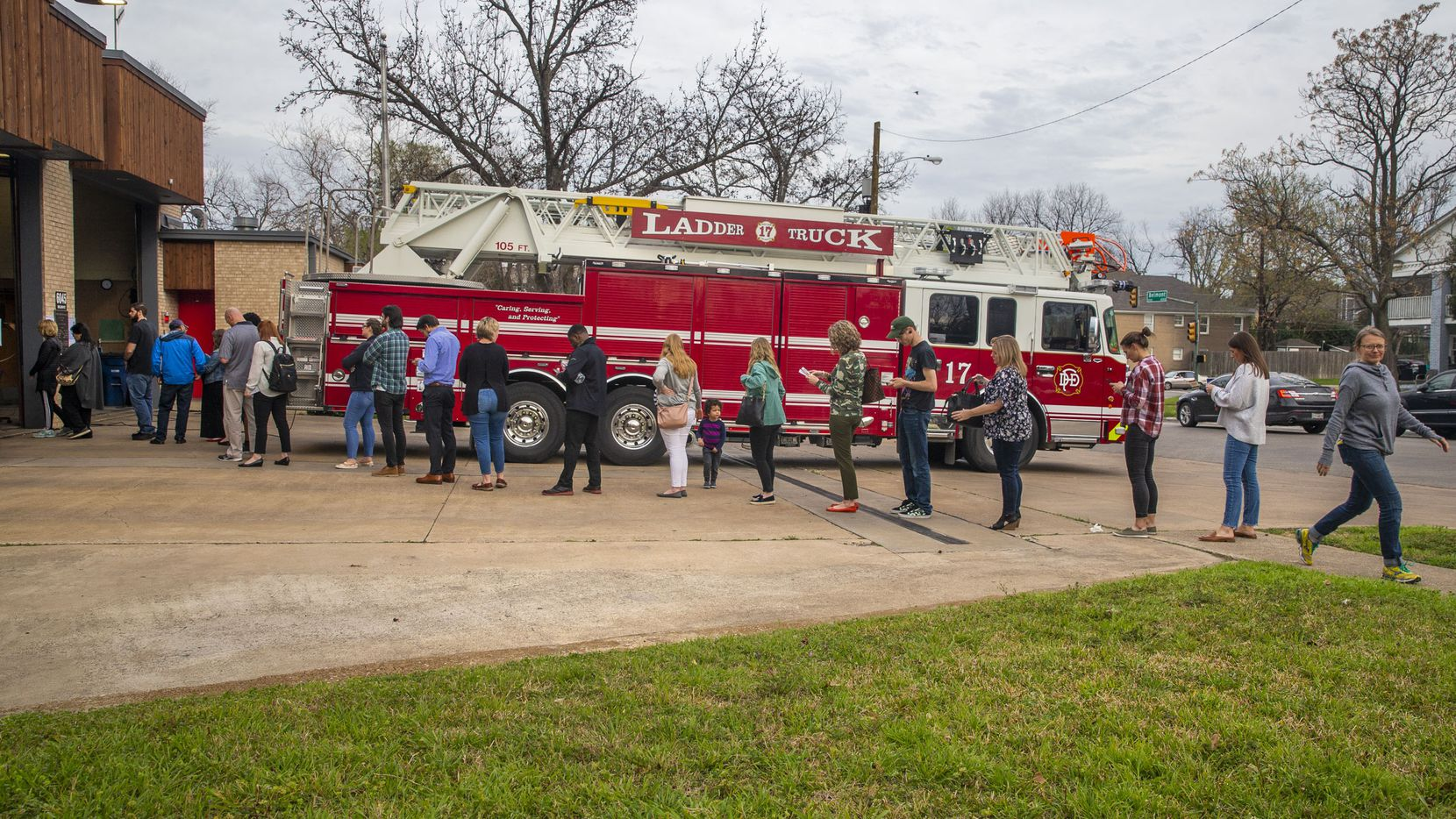 A long line of voters wait to cast their ballots in the primary election after 5 p.m. at Dallas Fire Station No. 17 in the Lakewood Heights neighborhood of Dallas on Tuesday, March 3, 2020.