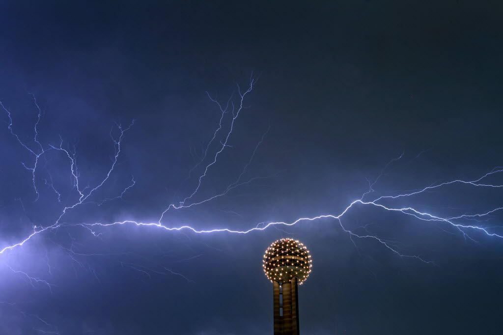 A file photo of lightning across the sky behind the Reunion Tower Ball in downtown Dallas, Sept. 29, 2011. (Brad Loper/The Dallas Morning News)