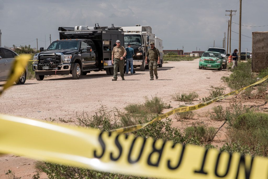 WEST ODESSA, TX - SEPTEMBER 1:  FBI agents search the residence of Seth Ator, the suspect in a deadly shooting spree on September 1, 2019 in West Odessa, Texas. Seven people had been killed, in addition to the gunman and at least 21 others were wounded, including three law enforcement officers after a gunman went on a rampage. The man who has not been identified fled from state troopers who had tried to pull him over. The gunman then hijacked a United States postal van and indiscriminately fired from a rifle at people before the authorities shot and killed him outside a movie theater in Odessa. (Photo by Cengiz Yar/Getty Images)