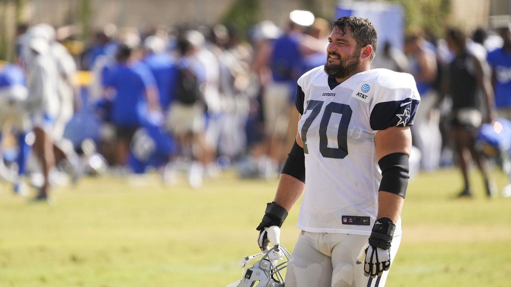 Dallas Cowboys guard Zack Martin (70) leaves the field following a joint practice with the Los Angeles Rams at training camp on Saturday, Aug. 7, 2021, in Oxnard, Calif.