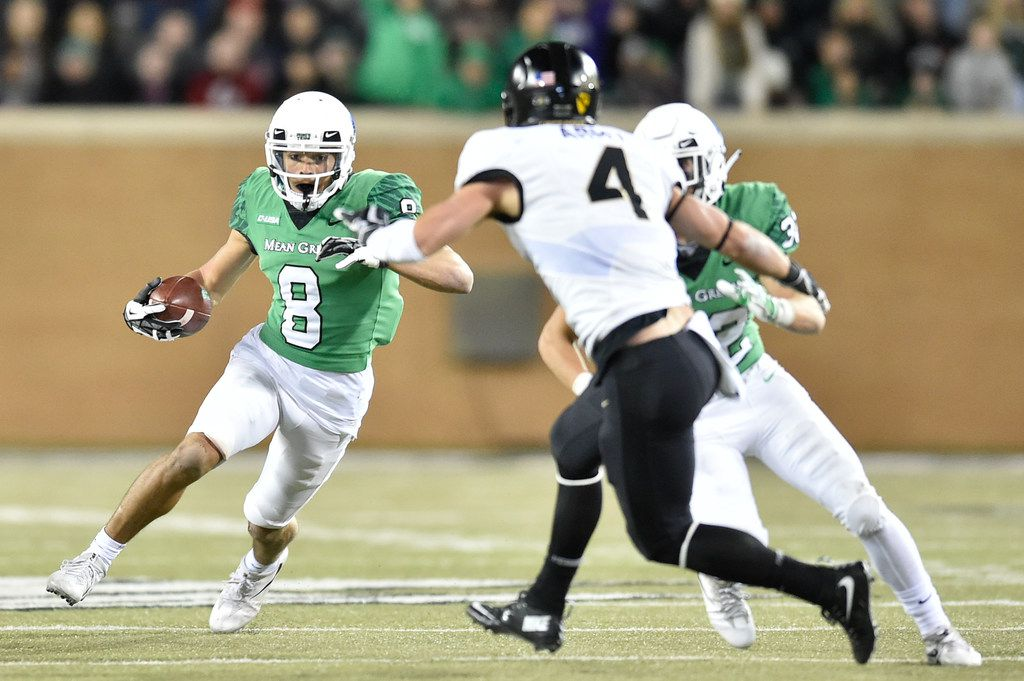 North Texas sophomore wide receiver Rico Bussey, Jr. (8) catches a pass and runs around Army junior defensive back MaxÊRegan (4) at Apogee Stadium, Saturday, November 18, 2017, in Denton, Texas, Jeff Woo/DRC