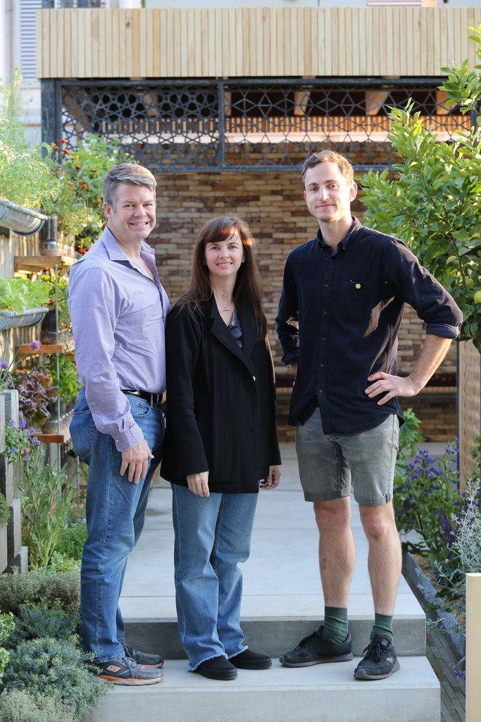 Hunter and Stephanie Hunt with designer Tom Massey in the Lemon Tree Trust Garden at the Chelsea Flower Show in London.