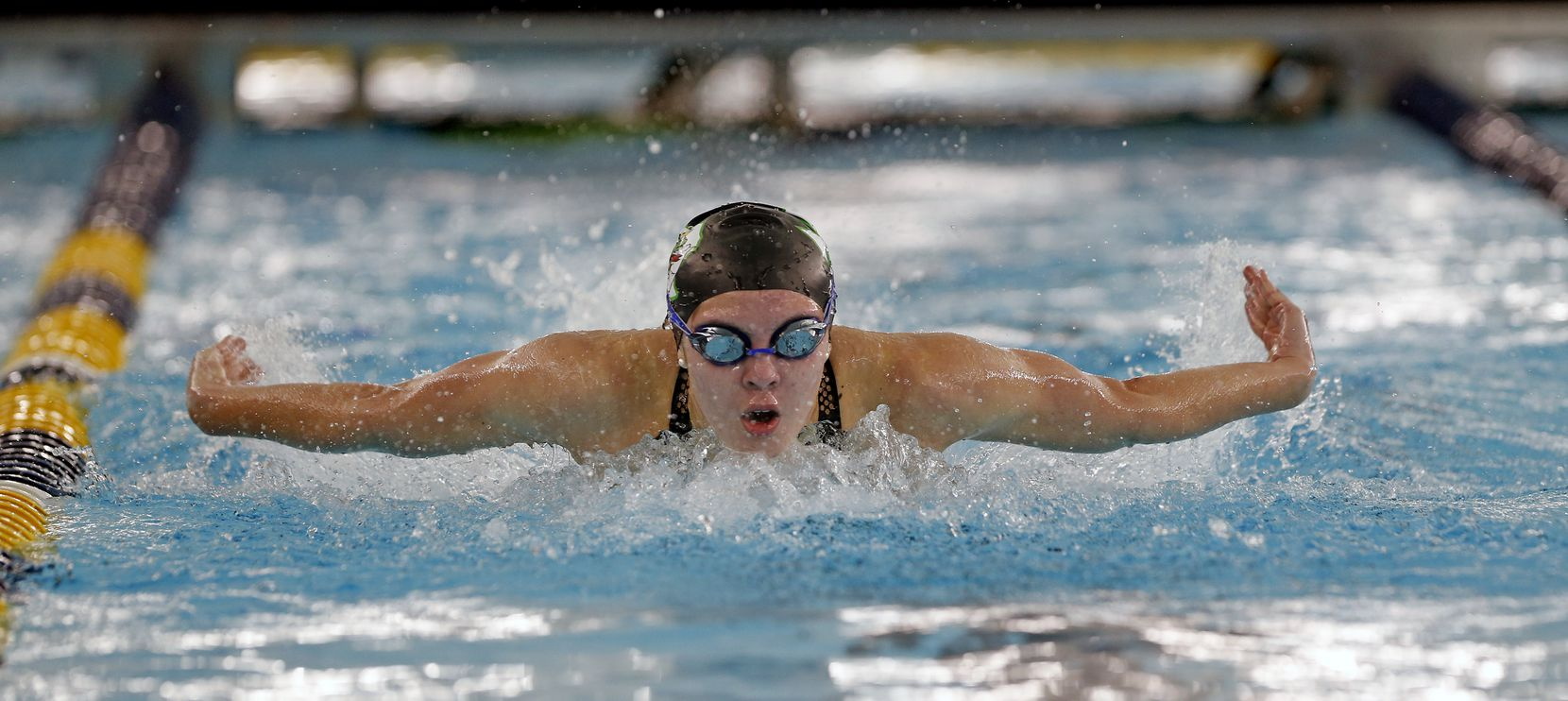 Corbyn Cormack, Southlake Carroll, shows her winning form in the 100-yard butterfly at the UIL Girls 6A Finals on Monday, March 1, 2021, at the Bill Walker Pool and Josh Davis Natatorium.