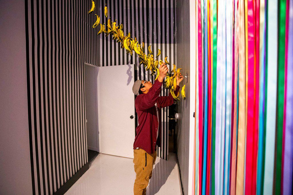 Angel Cruz, 19, plays with an art installation during a soft opening night at Rainbow Vomit on Thursday, Jan. 17, 2019. Rainbow Vomit is a new immersive art installation that will open on Saturday, January 19, 2019. (Shaban Athuman/The Dallas Morning News)