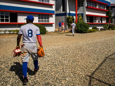 FILE - Infielder Luisangel Acuna heads toward the dorms after a tryout game at the Rangers' Dominican Republic academy on Monday, Jan. 22, 2018, in Boca Chica, Dominican Republic.