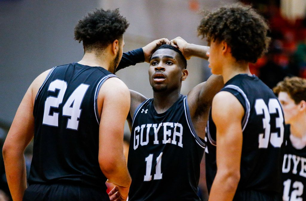Denton Guyer senior guard De'Vion Harmon (11) reacts to missing a free-throw as his teammates junior forward JaKobe Coles (24) and junior Eli Stowers (33) give encouragement during overtime of the Class 6A Region I championship boys basketball game against Duncanville at the Wilkerson-Greines Athletic Center in Fort Worth, Saturday, March 2, 2019. Duncanville won in overtime 66-62. (Brandon Wade/Special Contributor)