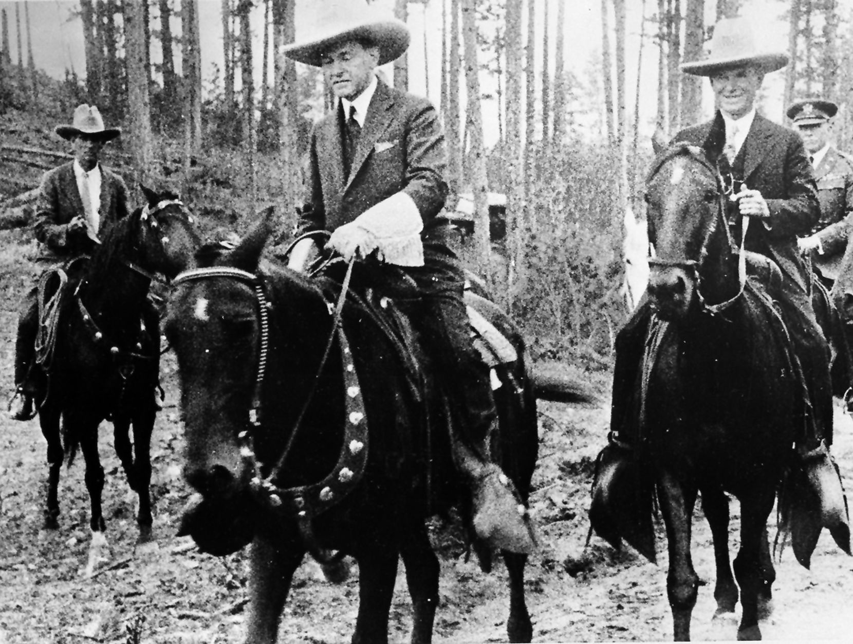 In this Aug. 15, 1927 photo, President Calvin Coolidge is on horseback to attend the dedication ceremony of the Mount Rushmore Memorial in South Dakota.