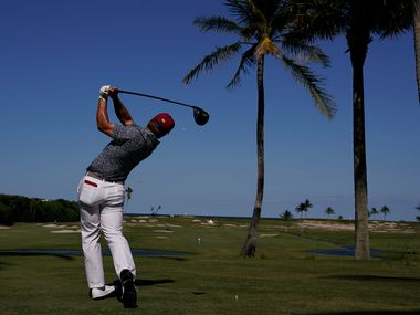 Pierceson Coody, of the USA team, watches his tee shot on the 12th hole in the singles matches during the Walker Cup golf tournament at the Seminole Golf Club on Saturday, May 8, 2021, in Juno Beach, Fla. (AP Photo/Brynn Anderson)