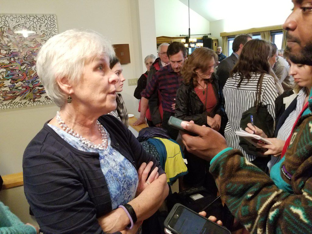 Deb Nelson, a history teacher who chairs the Hanover/Lyme Democratic Party, speaks with reporters after confronting presidential candidate Beto O'Rourke at a house party in Lebanon, N.H., on May 10, 2019. She was angry over his refusal to endorse Gina Ortiz Jones over GOP Rep. Will Hurd in the 2018 elections.