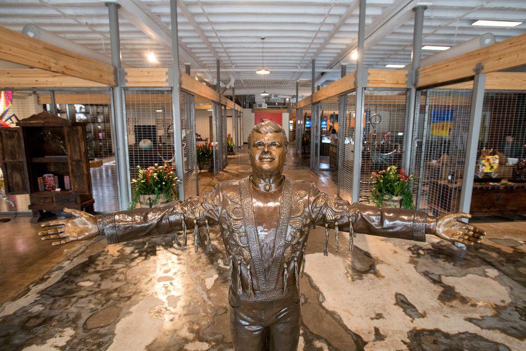 A statue of Mexican singer Juan Gabriel greets visitors.