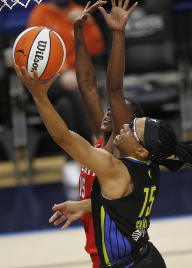 Dallas Wings guard Allisha Gray (15) drives for two points as she is defended by Atlanta Dream guard Tiffany Hayes (15) during second quarter action. Atlanta defeated Dallas 69-64. The two teams played their WNBA game at College Park Center on the campus of UT-Arlington on September 5, 2021. (Steve Hamm/ Special Contributor)