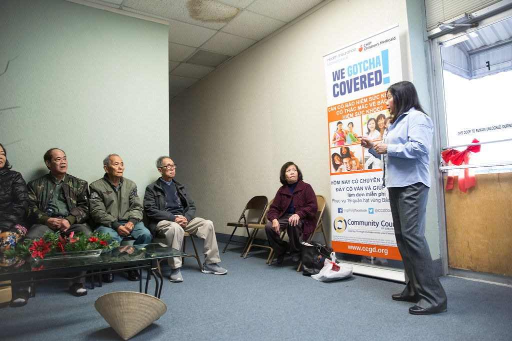 Lisa Pham, a Vietnamese-speaking health insurance marketplace navigator, speaks to a group of seniors at the Vietnamese community center in Pantego, Texas, on Nov. 8, 2017.