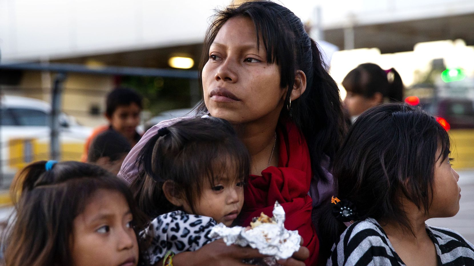 Patricia Giron held daughters Yesenia (left), 6; Wendy (center), 1; and Yocelyn, 6, at the temporary tent camp of asylum-seekers in Matamoros, Mexico, on Dec. 14, 2019. The Giron family, from Chiapas, Mexico, was living in temporary tent shelters under the Migrant Protection Policy, which required asylum-seekers to wait in Mexico while their claims were being processed.