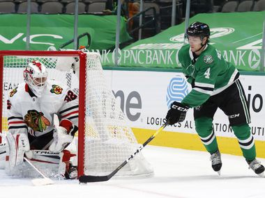 Dallas Stars defenseman Miro Heiskanen (4) attempts a shot on goal as Chicago Blackhawks goaltender Kevin Lankinen (32) makes the stop during the first period of play at American Airlines Center on Tuesday, February 9, 2021 in Dallas.