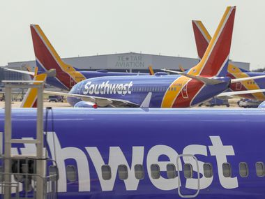 A Southwest Airlines flight taxis to the gate at Dallas Love Field.