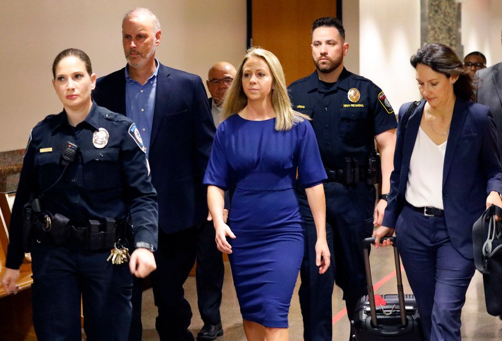 Fired Dallas police Officer Amber Guyger (center) arrives for the first day of her murder trial in the 204th District Court at the Frank Crowley Courts Building in Dallas on Monday. Guyger shot and killed Botham Jean, an unarmed 26-year-old neighbor in his own apartment last year. She told police she thought his apartment was her own and that he was an intruder.