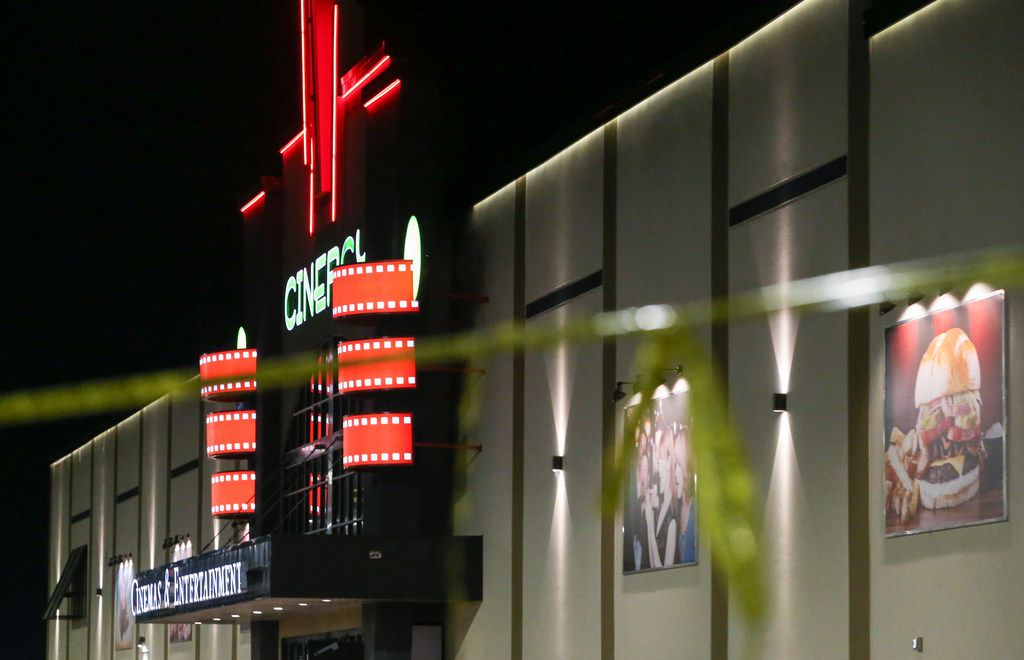 Police tape hangs at a Cinergy movie theatre Saturday, Aug. 31, 2019 in Odessa, Texas. At least five people died after more than 20 people were shot Saturday when a gunman hijacked a postal truck and began shooting randomly in the Odessa area of West Texas, authorities say.(Ryan Michalesko/The Dallas Morning News)