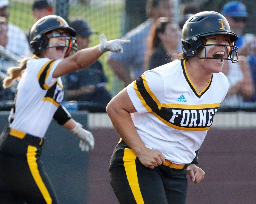 Forney High School second baseman Trinity Cannon (right) and outfielder Hannah Holdbrook recognize the teammate responsible for scoring them both in the second inning as Forney High School played Frisco Reedy High School in a one game playoff for the Class 5A Region II final on Friday, May 24, 2019.  (Stewart F. House/Special Contributor)