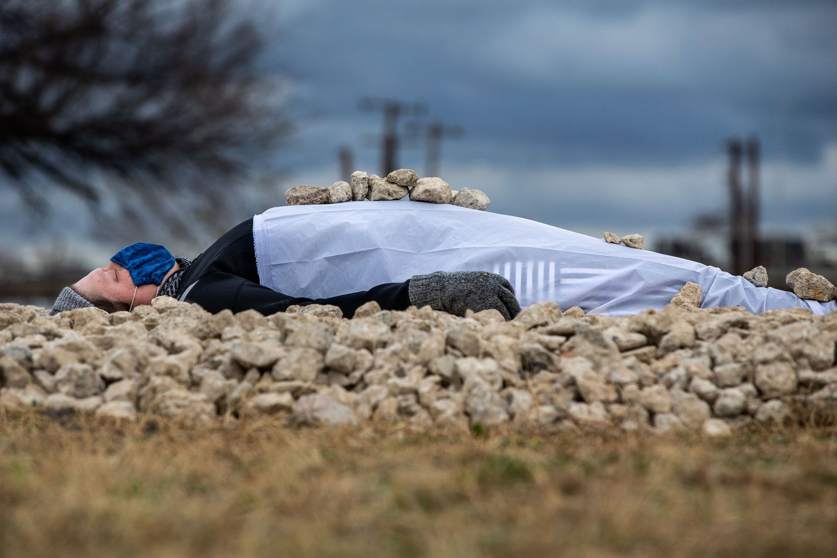 Erica Felicella lies on a bed of stones for her performance in the Cedars Tuesday.
