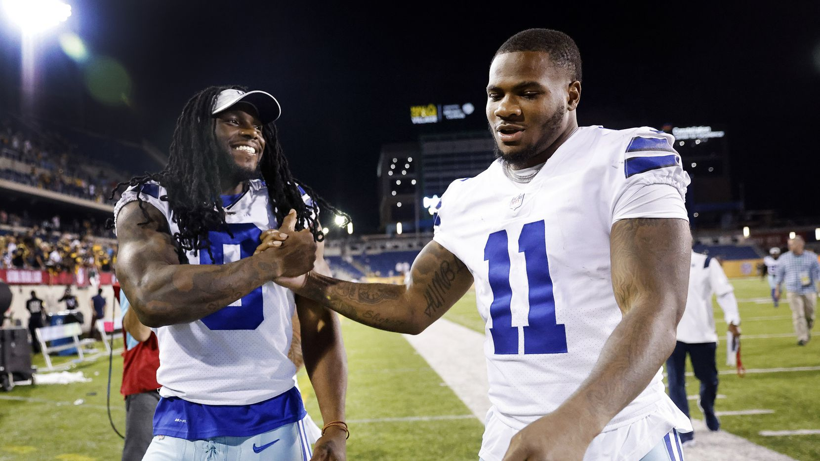 Dallas Cowboys linebacker Jaylon Smith (9) congratulates rookie linebacker Micah Parsons (11) after his first game. Parsons had a fumlbe recovery during their preseason game with the Pittsburgh Steelers at Tom Benson Hall of Fame Stadium in Canton, Ohio, Thursday, August 5, 2021.