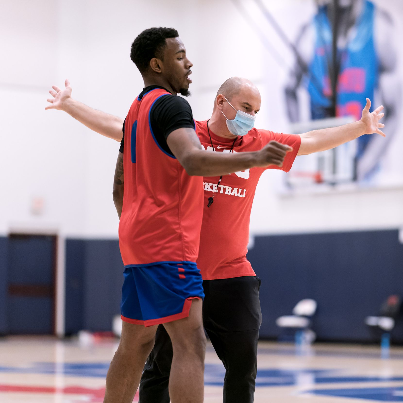 Tyson Jolly works with player development coach Nemanja Jovanovic. Jolly returned to the court for his first game on Saturday.