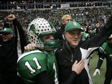 Southlake Carroll head coach Todd Dodge (right) and his sophmore son Riley Dodge (11) celebrate their 5A Division II Championship win over Katy at Texas Stadium on December 16, 2005. Riley, now the head coach at Southlake Carroll, is scheduled to face Todd's Austin Westlake team in Week 1 of the 2020 season.