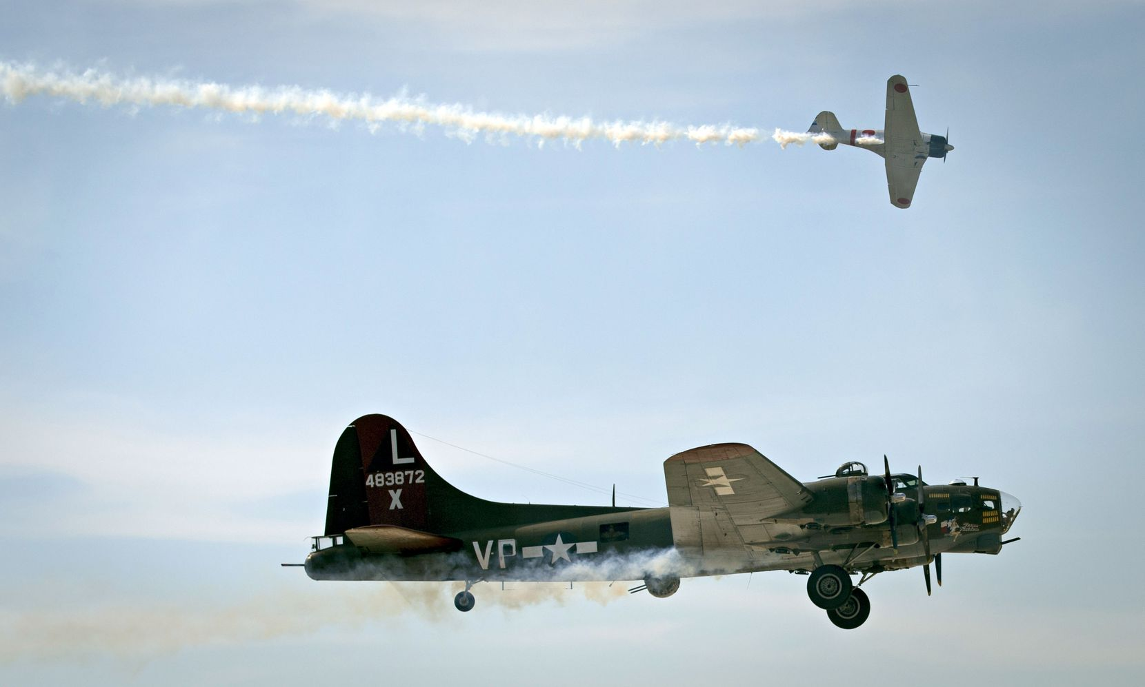 A B-17 and Japanese Zero airplane streak across the skies during a previous Wings Over Dallas WWII Air Show. The 2021 event takes off Oct. 29.