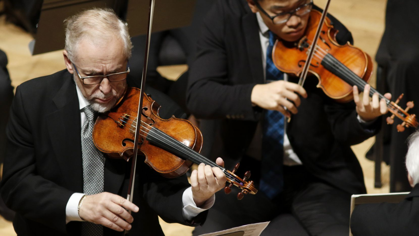 On left, Emanuel Borok performs with the Meadows Symphony Orchestra performance at Caruth Auditorium in the SMU Owens Arts Center in Dallas on Nov. 1, 2015.