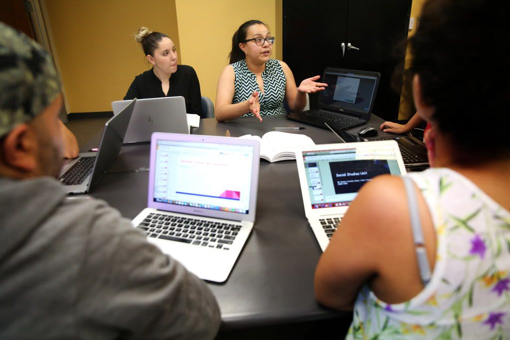 Dianna Huerta (right) and Yurisela Davila, students in UNT-Dallas' School of Education, worked with others on a group project during an educational leadership class at the campus in Dallas in July. (Rose Baca/Staff Photographer)