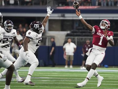 Arkansas quarterback KJ Jefferson (1) throws a pass under pressure from Texas A&M defensive lineman DeMarvin Leal (8) during the first half of an NCAA football game at AT&T Stadium on Saturday, Sept. 25, 2021, in Arlington.