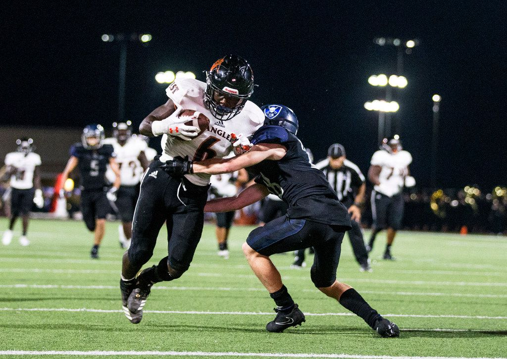 West Mesquite's Ty Jordan (6) makes his way past Wylie East defensive back Jacob Kelley (28) to score a touchdown during a football game between West Mesquite and Wylie East on Thursday, September 27, 2018 at Wylie Stadium in Wylie, Texas. (Shaban Athuman/The Dallas Morning News)
